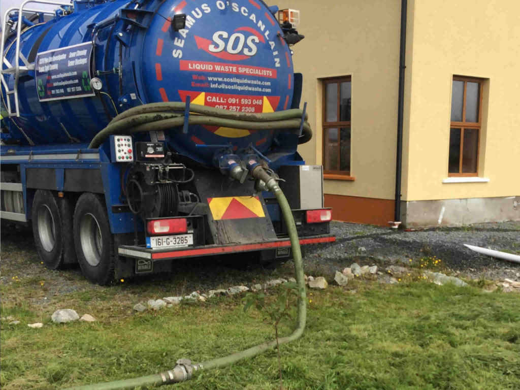 SOS Liquid Waste lorry at residential home